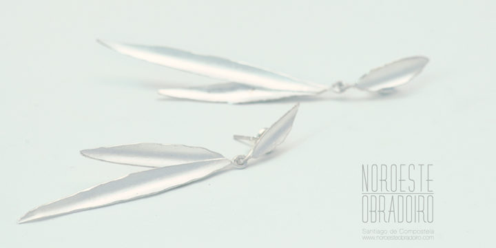 silver earrings in the shape of bamboo leaves handmade by jewellers in Santiago de Compostela, Galicia