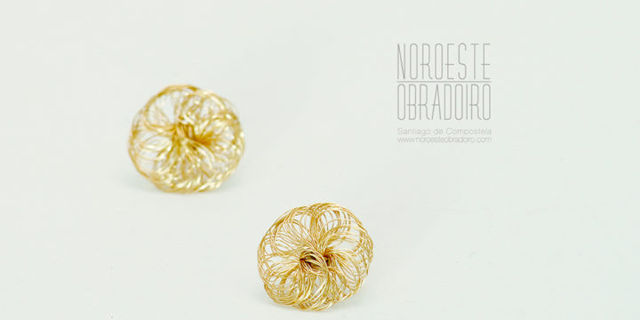 small gold earrings made in Northwest Obradoiro jewellery shop in Santiago de Compostela, Galicia
